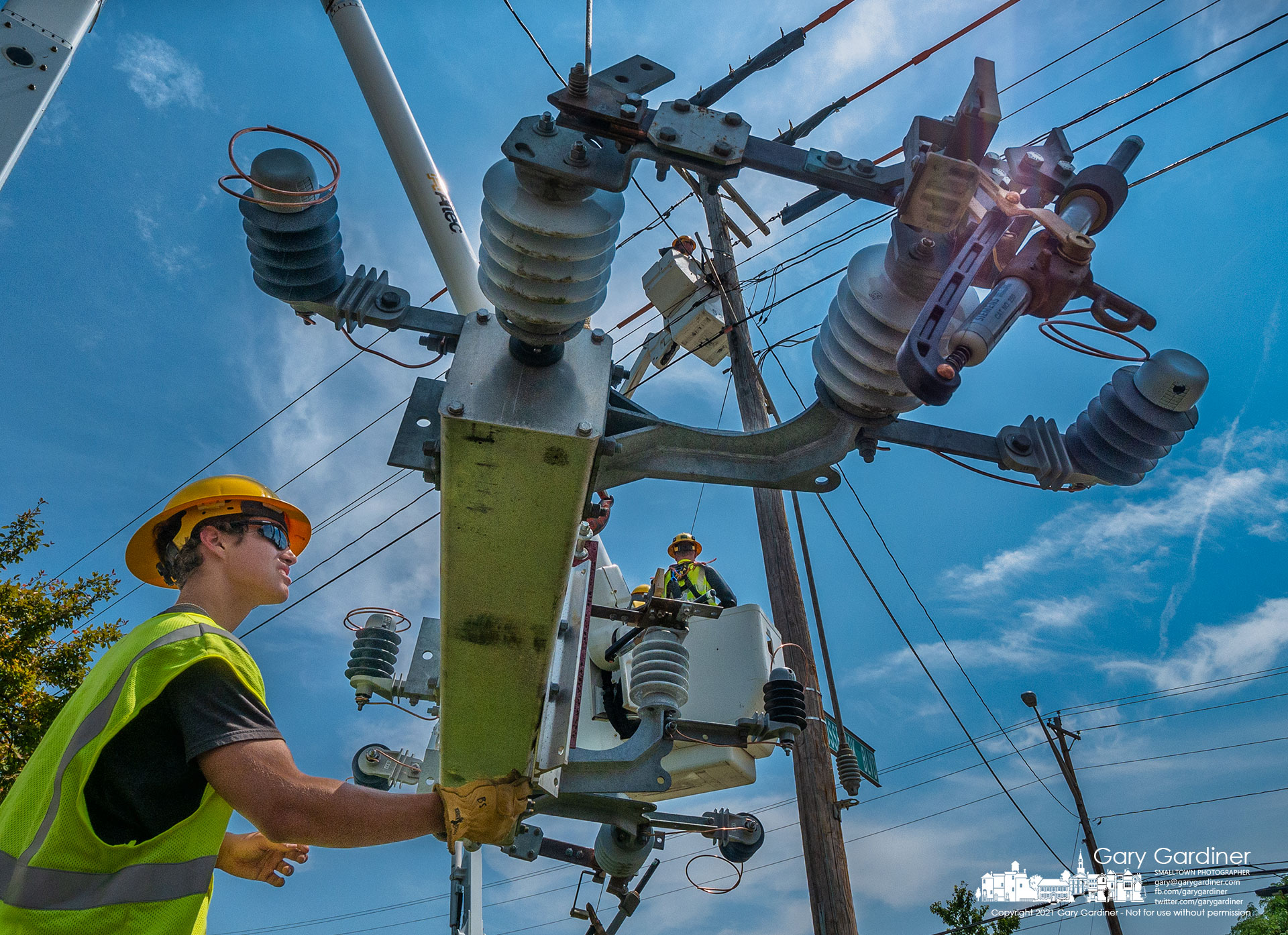 A city electric crew replaces a worn and damaged switch on a utility pole on Schrock Road. My Final Photo for July 22, 2021,