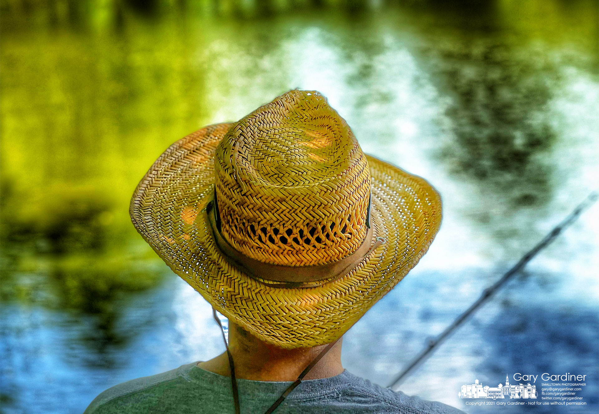 A fisherman wears a straw hat as protection from the sunas he fishes along the shoreline of Hoover Reservoir. My Final Photo for July 3, 2021.