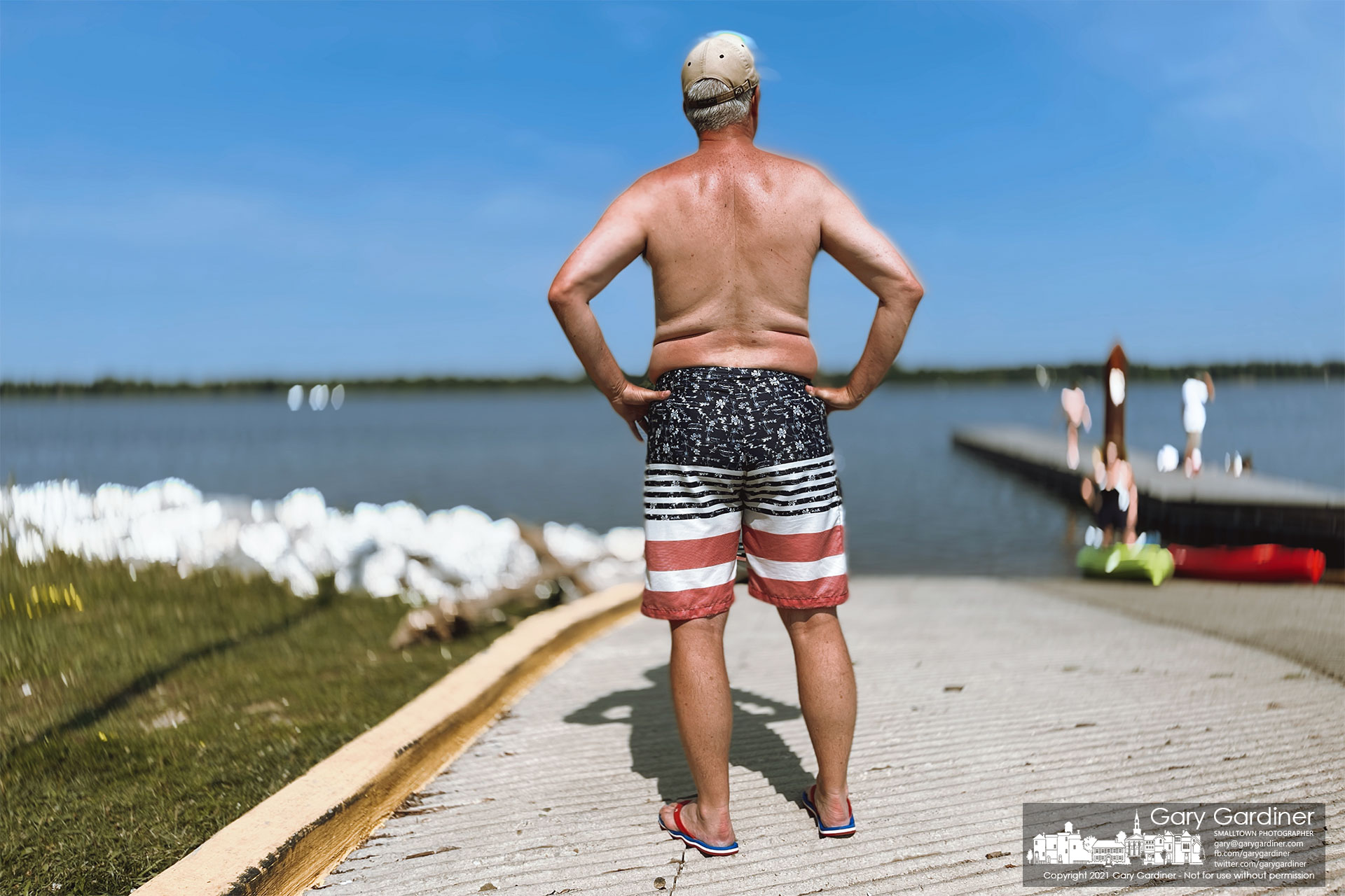 A kayaker waits at the Oxbow boat ramp for his fellow sailors to return to shore completing an afternoon paddling Hoover Reservoir on July 4th. My Final Photo for July 4, 2021.