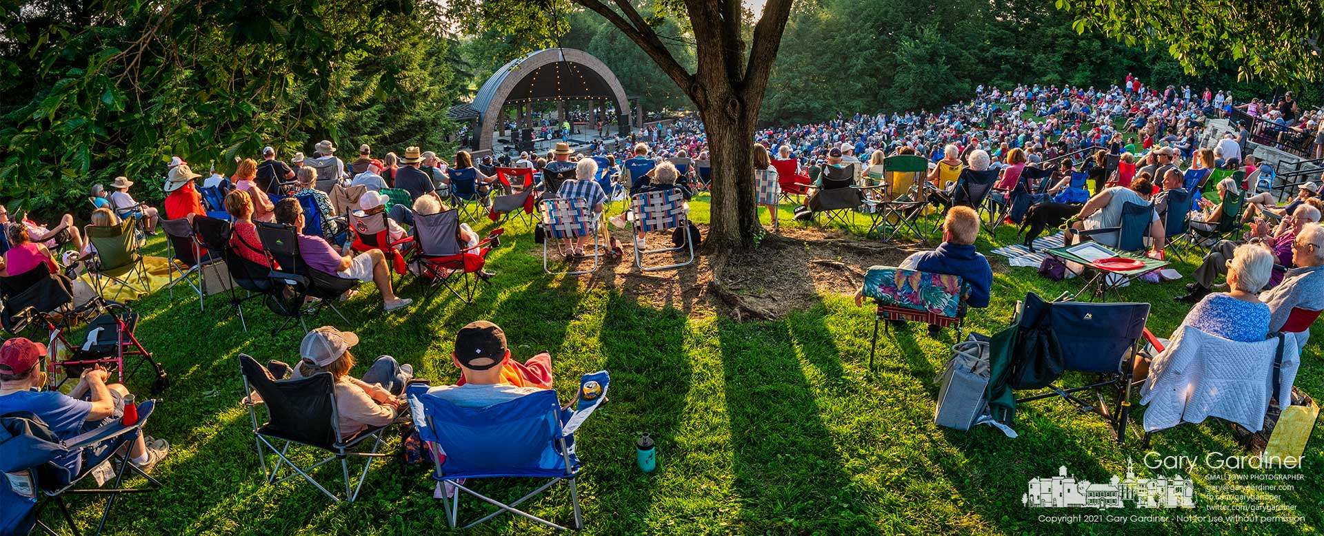 """An overflow crowd gathers on the lawns at the Westerville Amphitheatre Sunday evening to hear """"The British Invasion"""" as part of the Summer Concert Series that was canceled last year because of the pandemic. My Final Photo for August 1, 20-21."""