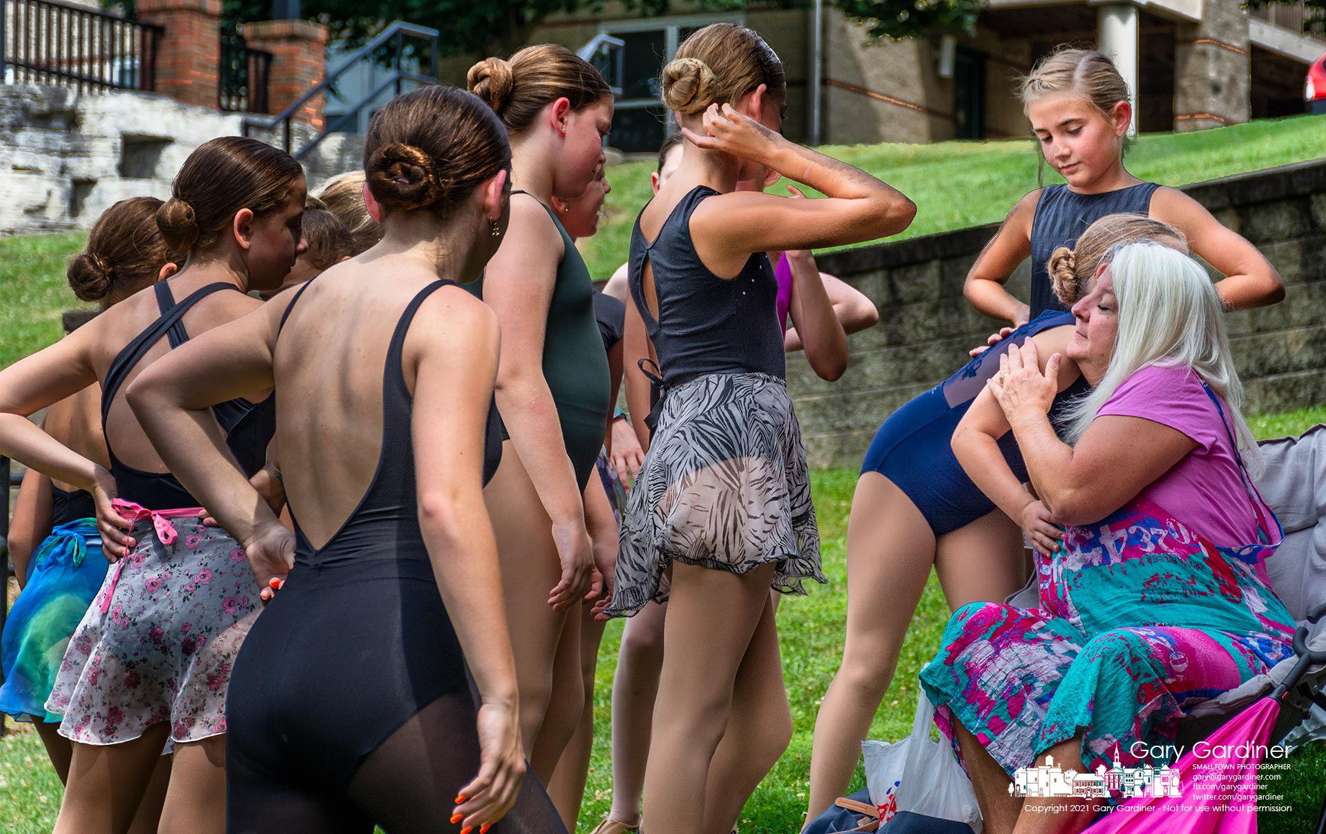 Angie Haver receives hugs from Generations dancers at the Alum Creek Amphitheater after their performance marking the end of summer camp which Haver didn't get to help teach as she recovered from Covid. My Final Photo for Aug. 6, 2021.