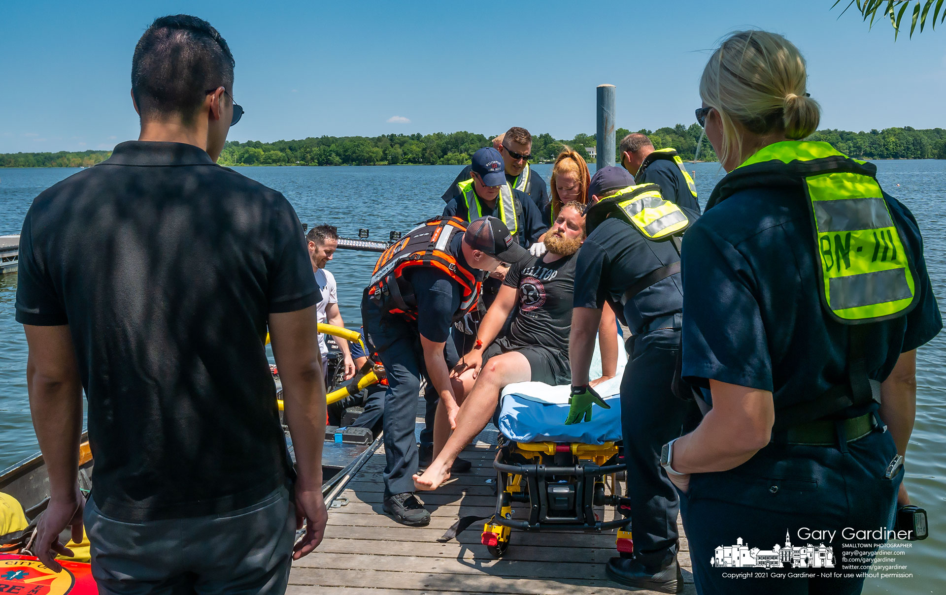Firefighters move another firefighter to a gurney sitting on the dock at Red Bank Marina under the watch of a doctor and deputy fire chief during water rescue training on Hoover Wednesday. My Final Photo for Aug. 4, 2021.