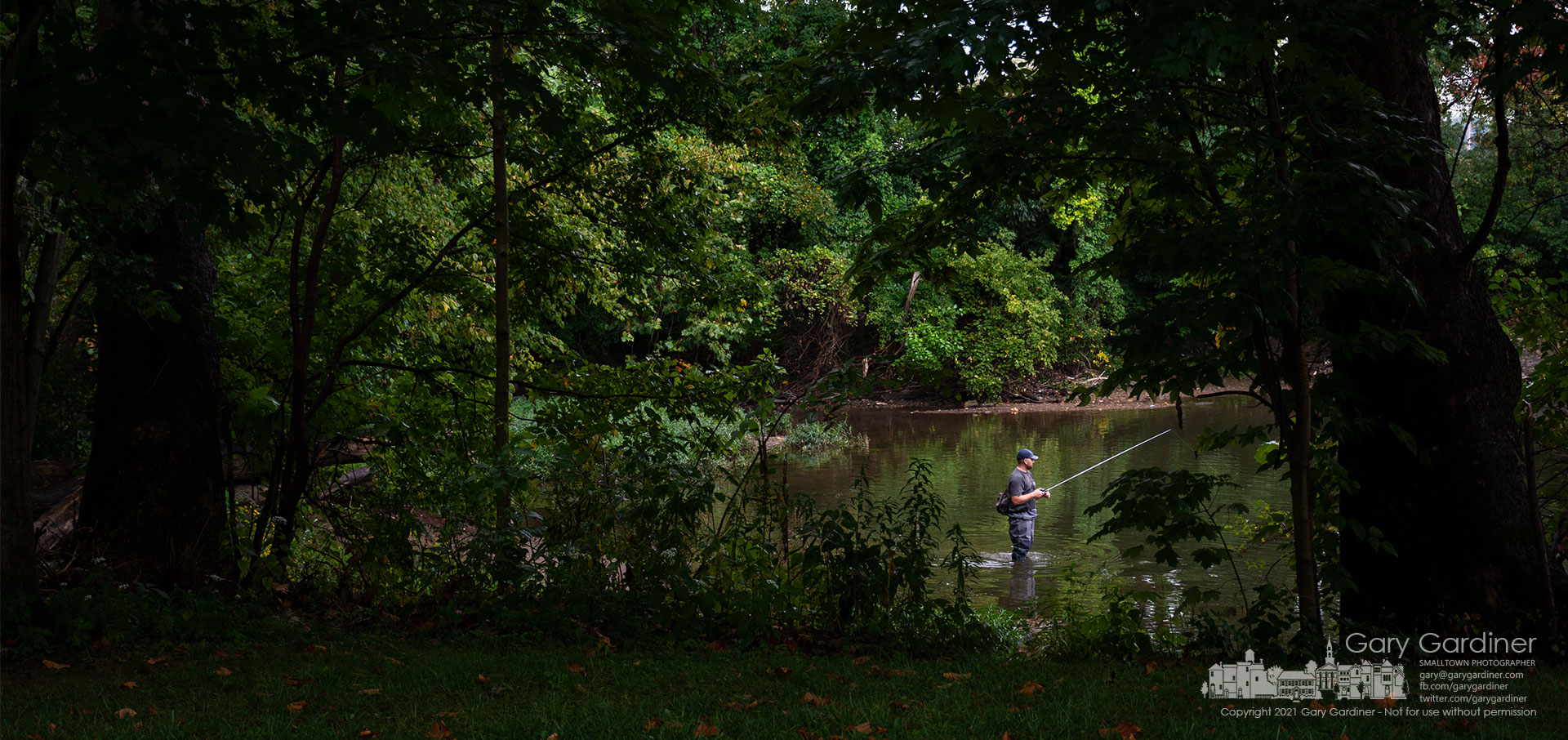 A fisherman tries his luck below the spillway for the Westerville Alum Creek dam during rain showers Tuesday afternoon. My Final Photo for Sept. 15, 2021.