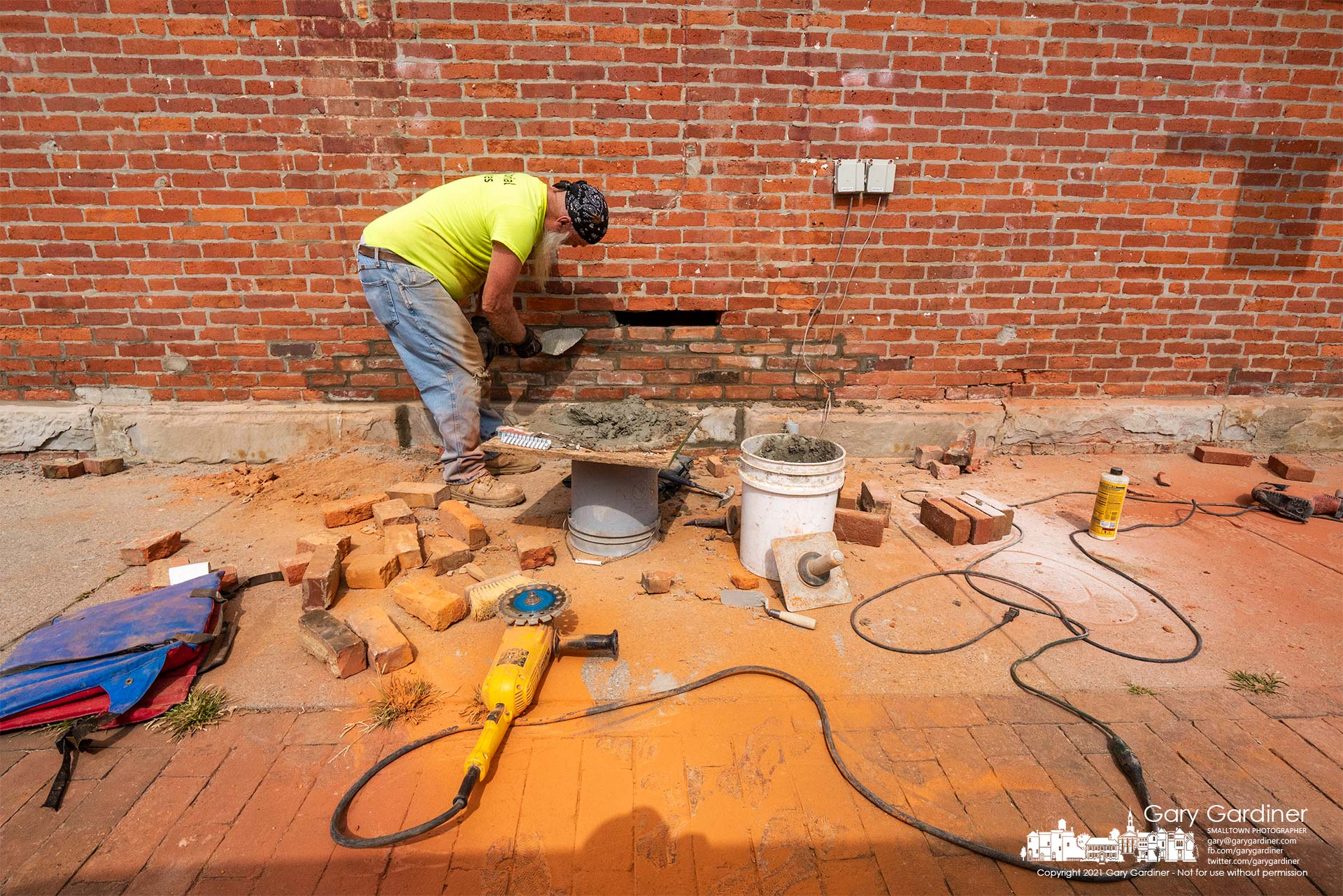 A brick mason replaces old brick and tuck-points the mortar joints between others to refresh the exterior of a section of the Graeter's Ice Cream store in Uptown Westerville. My Final Photo for Sept. 28, 2021.