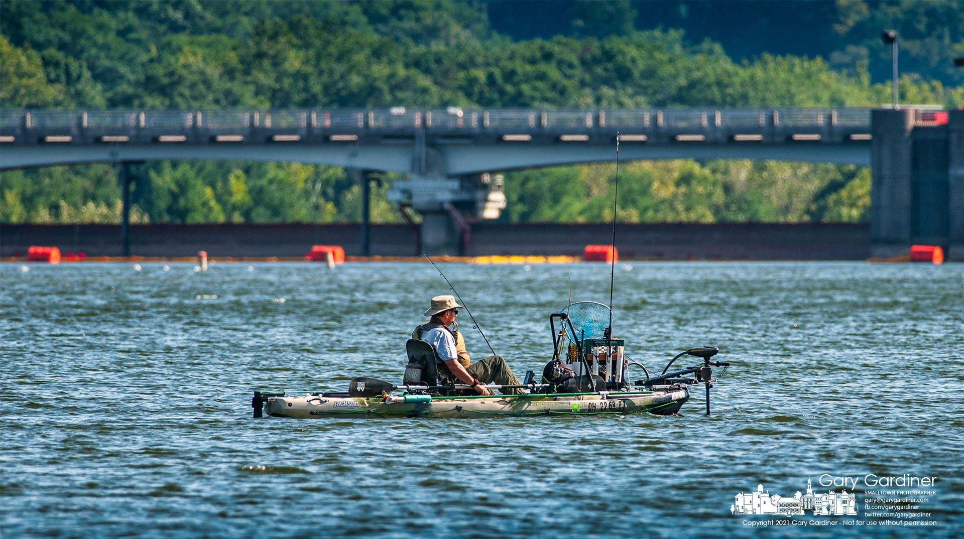 A fisherman shifts his position just above the dam at Hoover Reservoir during a Tuesday afternoon session on the lake. My Final Photo for Sept. 7, 2021.