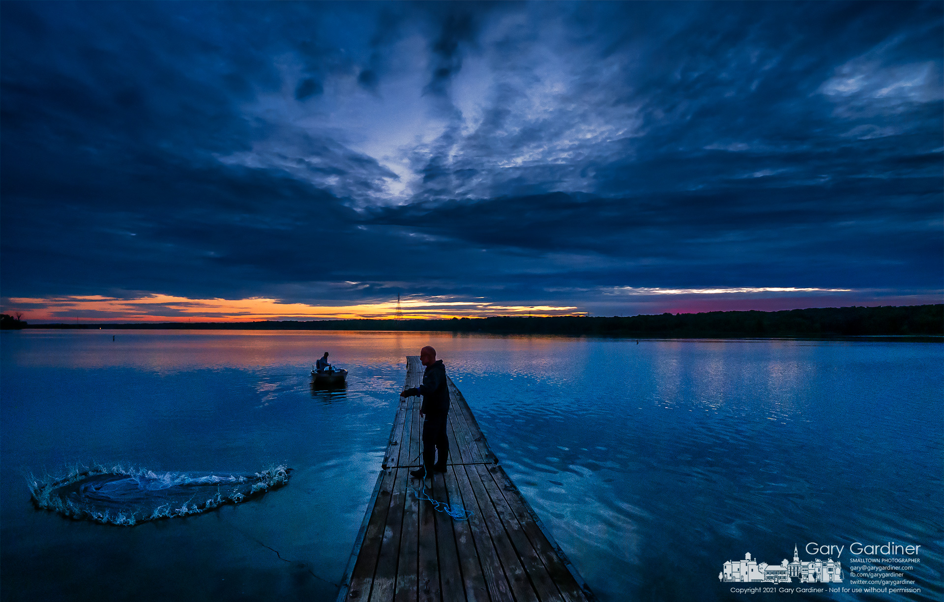 A fisherman casts for baitfish just before sunrise where he and his fishing companions prepared to launch a day of fishing dreams on Hoover Reservoir. My Final Photo for Sept. 4, 2021.