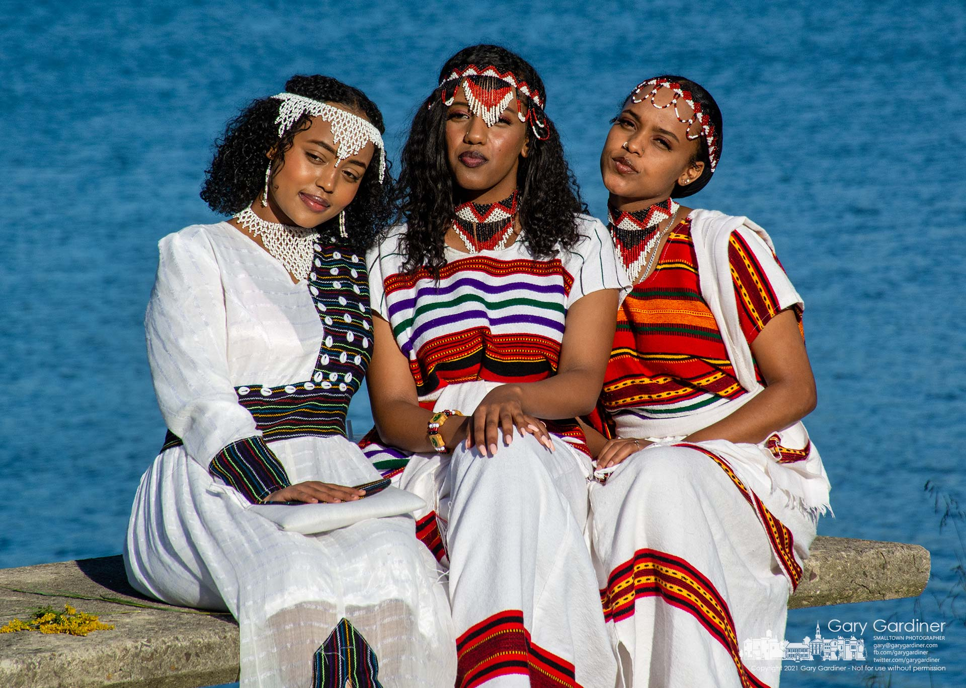 Three Oromia women wearing chelie beadwork pose for a photo with their family during the group's celebration of Irreecha, a tradition marking the end of the rainy season for the regional state in Ethiopia. My Final Photo for Sept. 26, 2021.