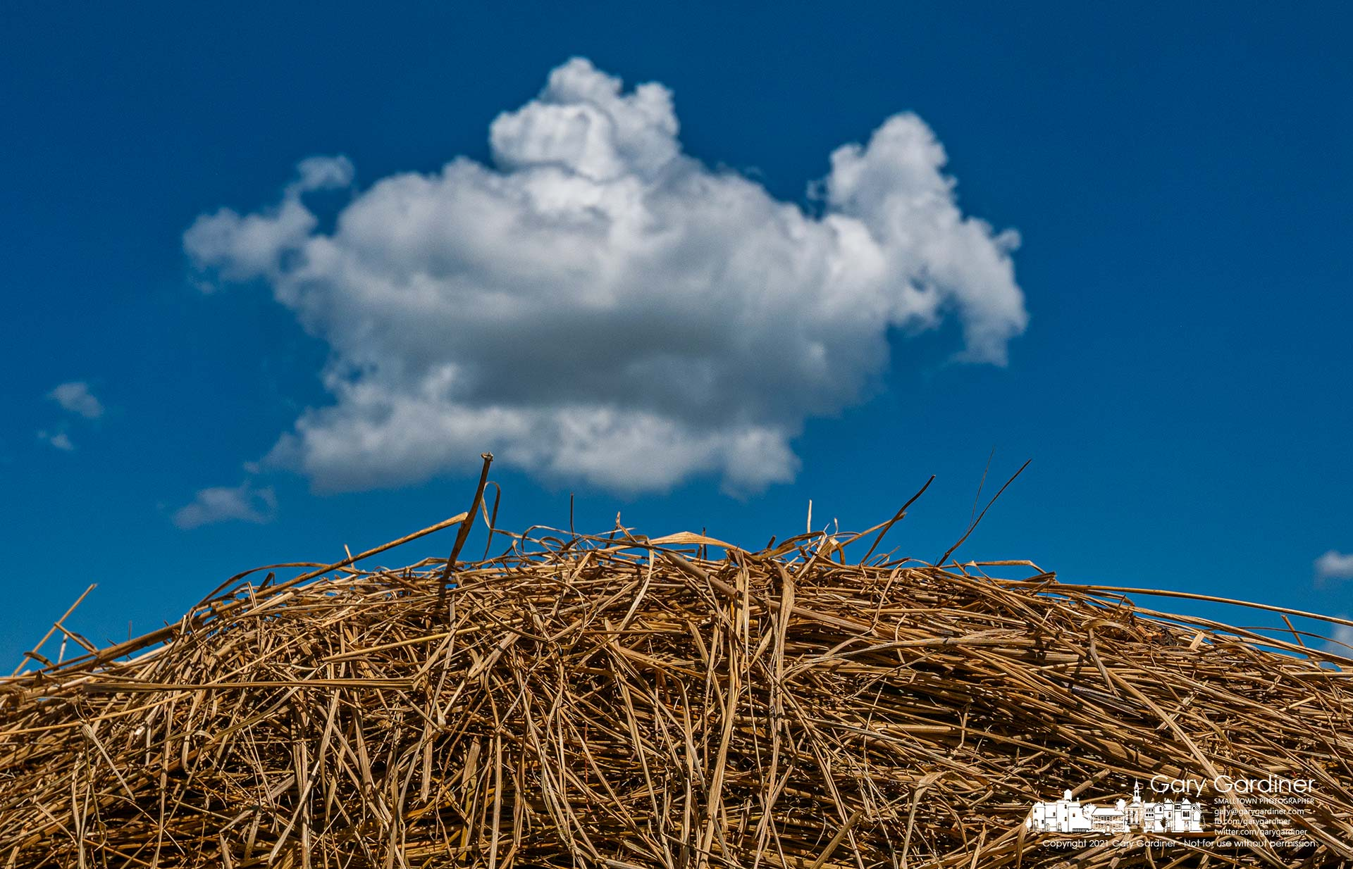 Afternoon clouds travel across a field with scattered bales of late-season hay. My Final Photo for Sept. 17, 2021.