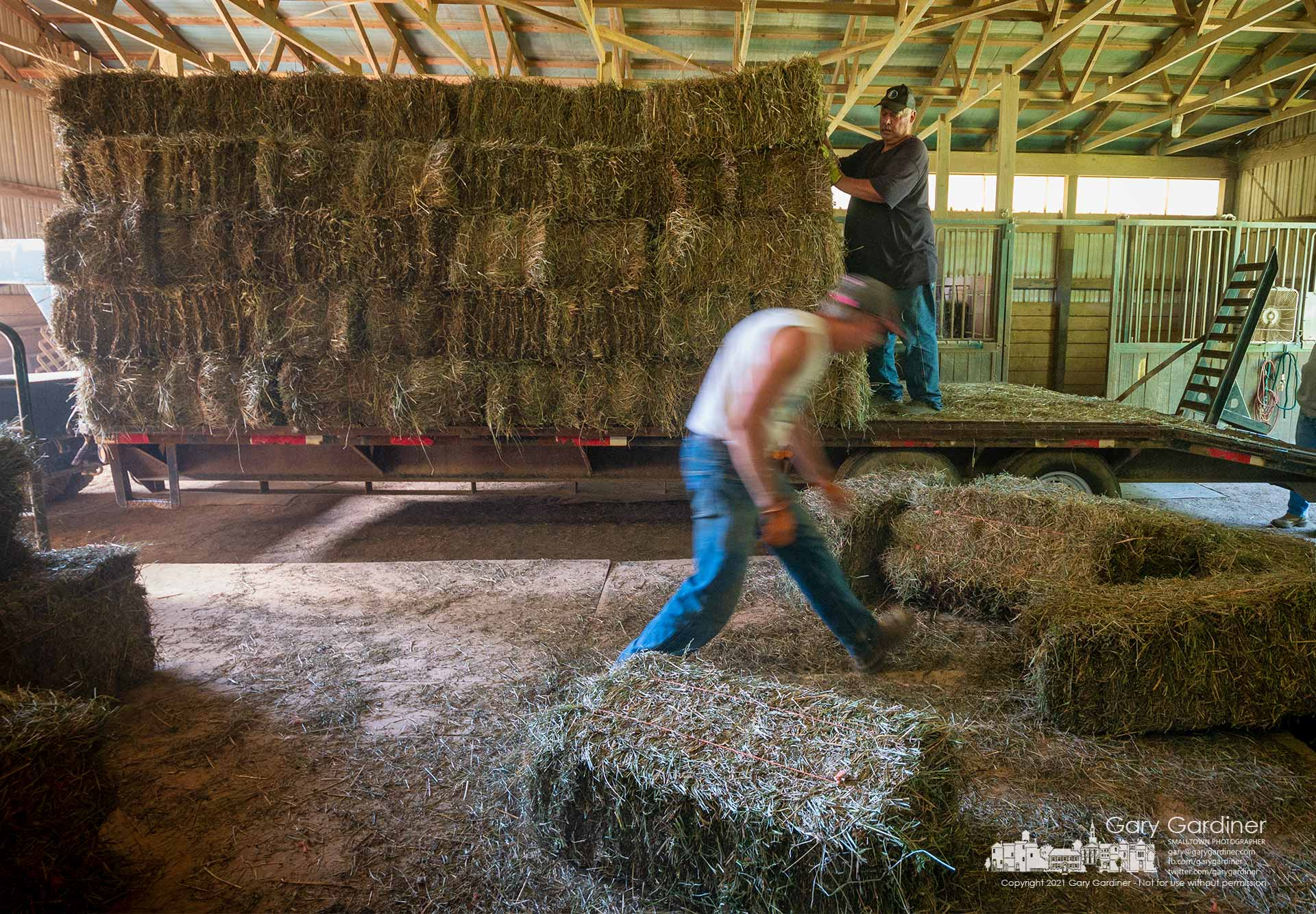 Rodney Parker and Kevin Scott deliver a wagon of hay to a horse barn near Croton, Ohio. My Final Photo for Sept. 2, 2021