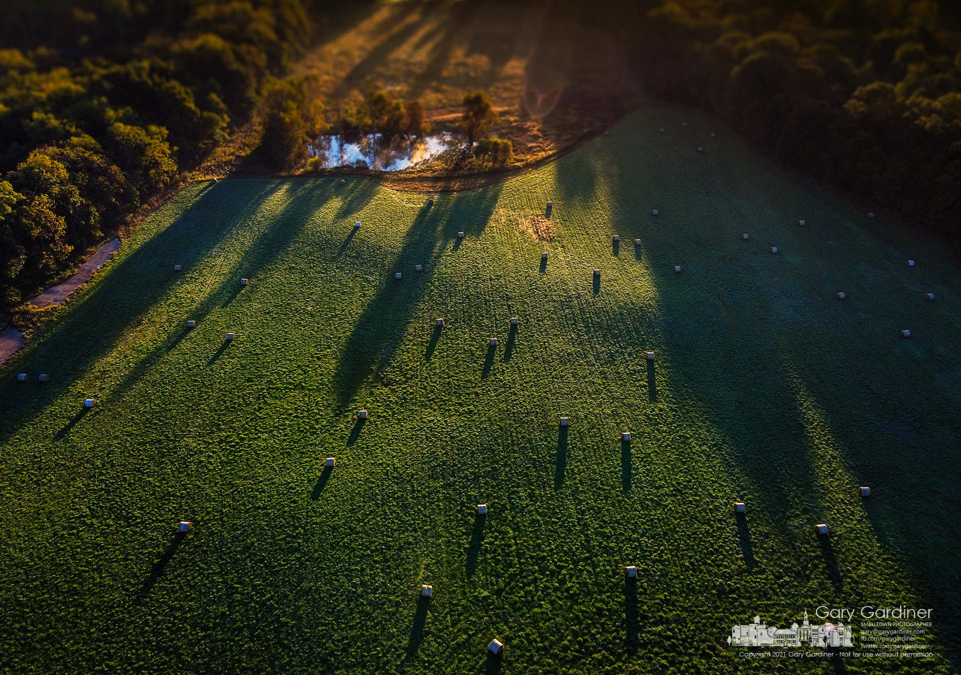 The morning sun casts shadows across the small pond, hayfield, and round bales on a section of the Sharp Farm on Africa Road. My Final Photo for Sept. 30, 2021.