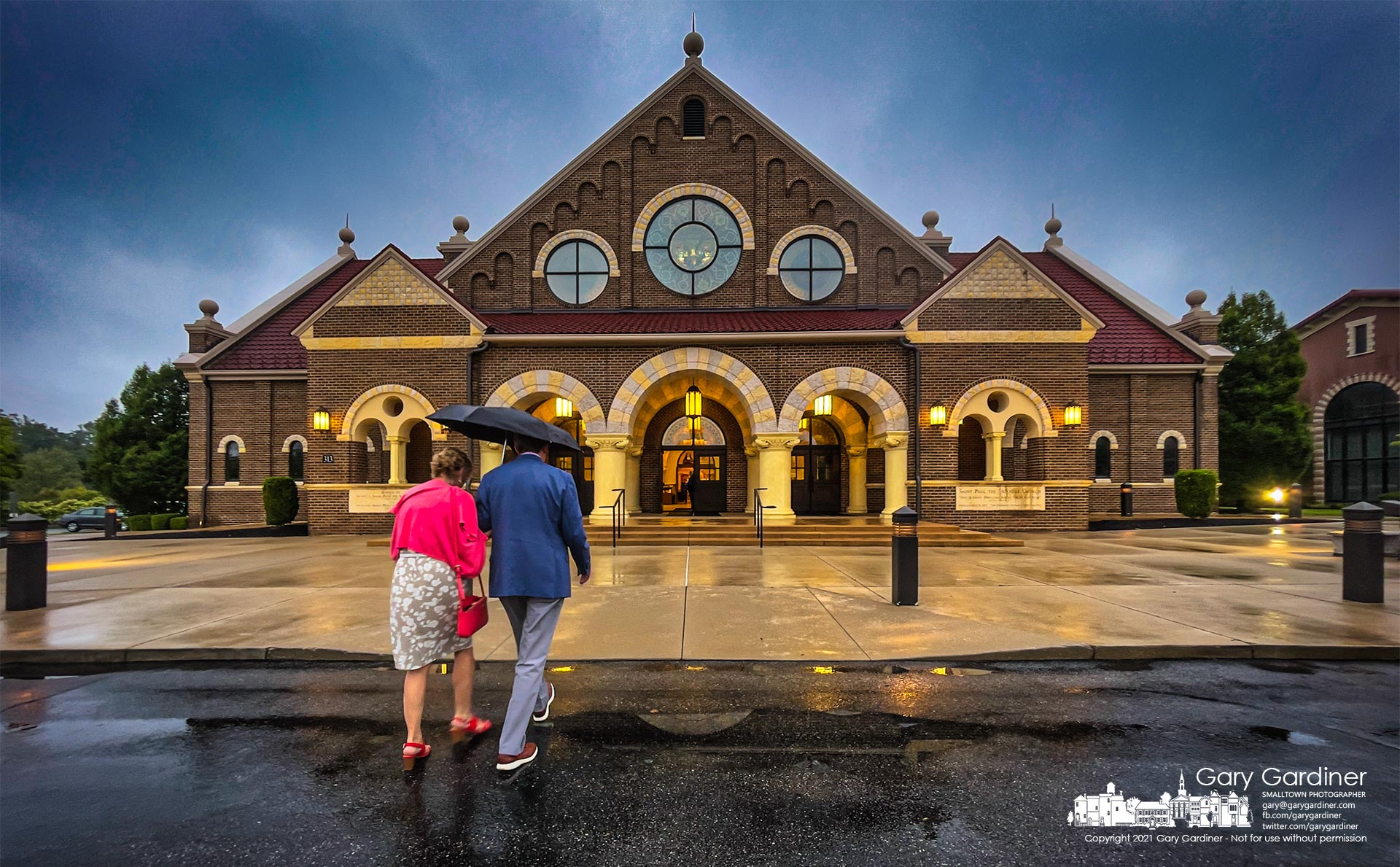 Parishioners arrive in the rain for the first Sunday Mass at St. Paul the Apostle Catholic Church in Westerville. My Final Photo for Sept. 5, 2021.