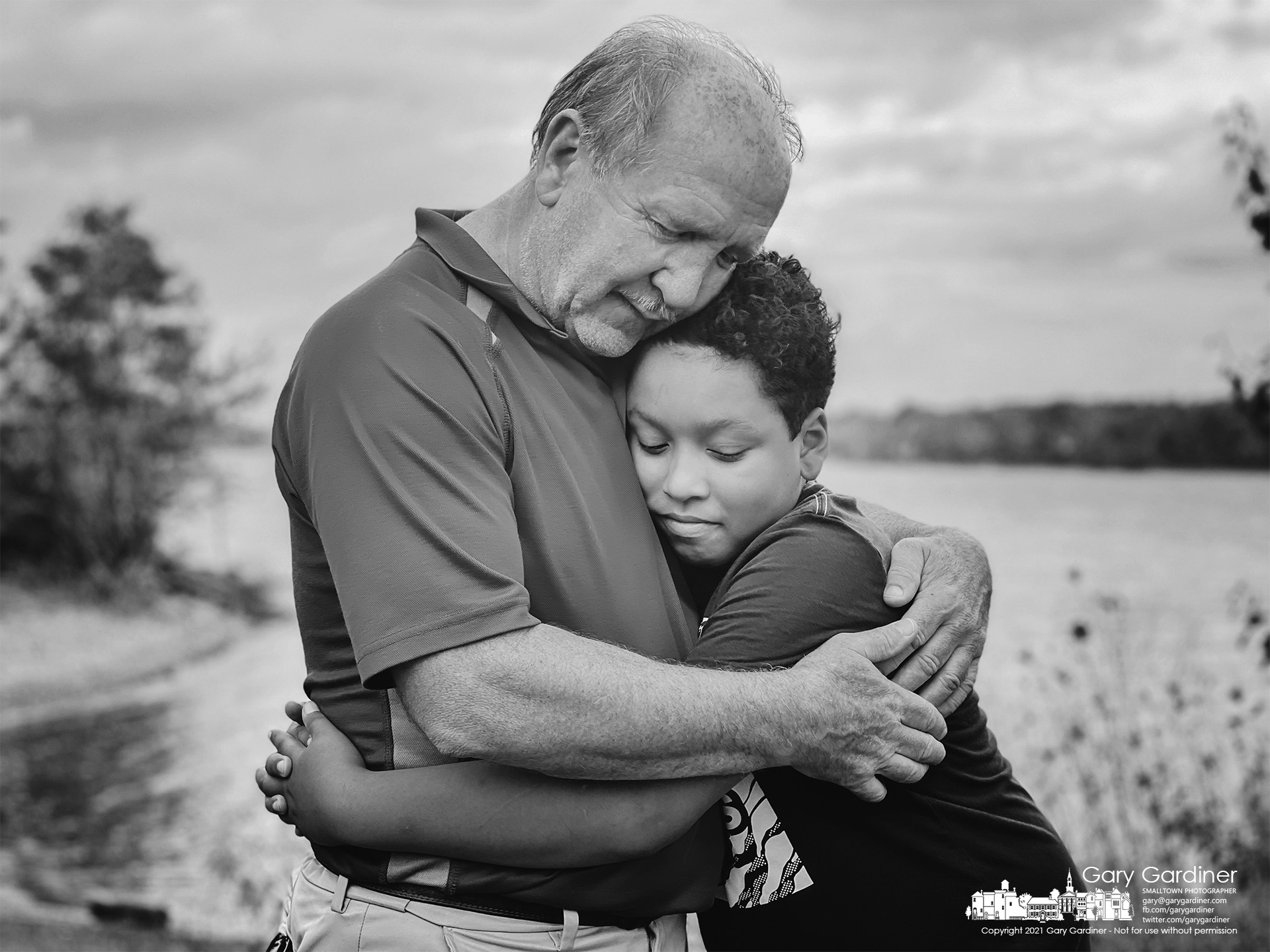 Grandfather and grandson embrace at the end of an afternoon enjoying themselves on the shores of Hoover Reservoir at Red Bank Park. My Final Photo for Oct. 15, 2021.