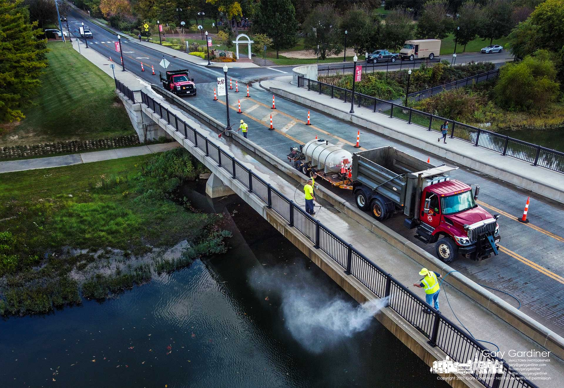 A Franklin County work crew pressure washes the Main Street bridge sidewalks and railing in preparation for sealing the sidewalks on the 10-year-old bridge. My Final Photo for Oct.14, 2021.