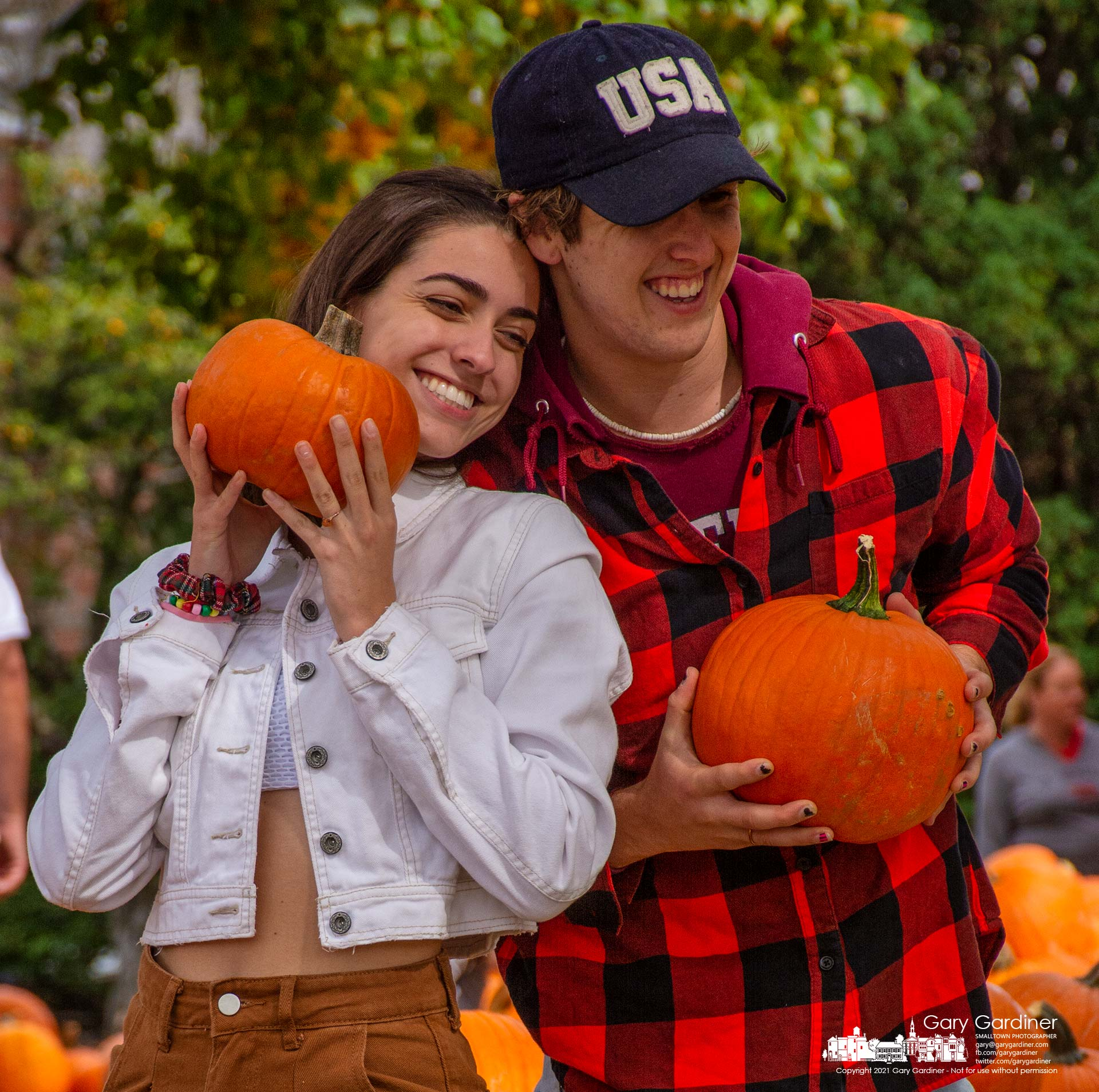 Otterbein students pause to record their pumpkin purchase from the Boy Scout Troop Pumpkin Patch in front of the Masonic Hall on South State Street in Westerville. My Final Photo for Oct. 2, 2021.