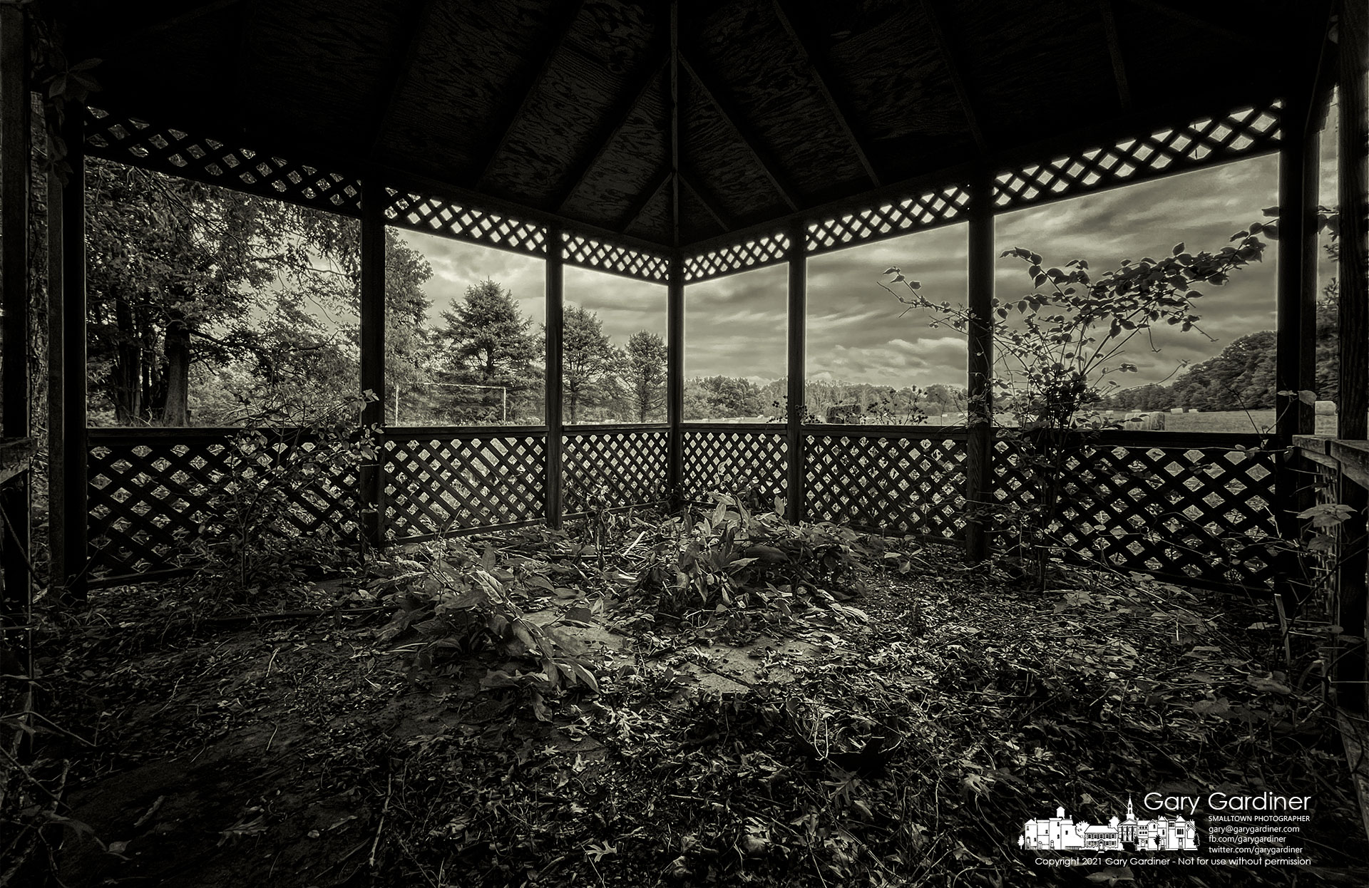 Weeds, leaves, and farm debris litter the floor of the abandoned gazebo on the Sharp Farm property as developers plan for homes, apartments, and businesses on the land around the historic house that once was a station on the Underground Railroad. My Final Photo for Oct. 7, 2021.