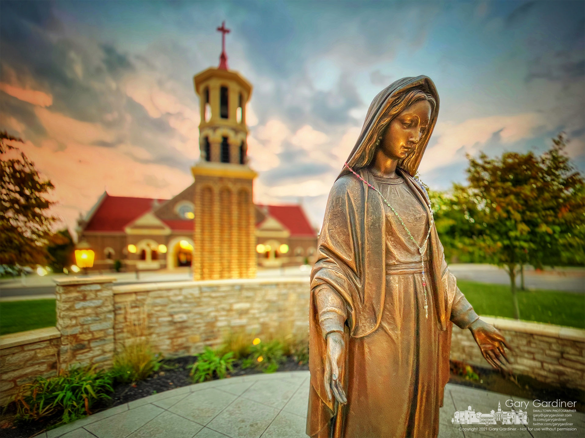 The statue of Mary near the entrance to St. Paul the Apostle Catholic Church is bathed in morning light at sunrise before the first Sunday Mass. My Final Photo for Oct. 10, 2021.